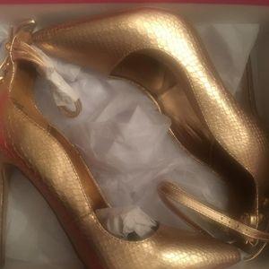 A rose gold pump heel